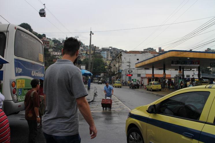 Man keeping his backbag safe in Rio de Janeiro